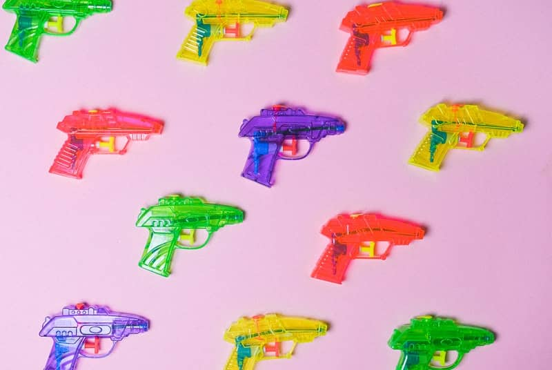 Colorful squirt guns to symbolize female squirting orgasm