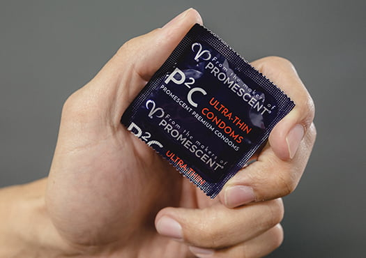 Promescent ultra thin condoms in hand