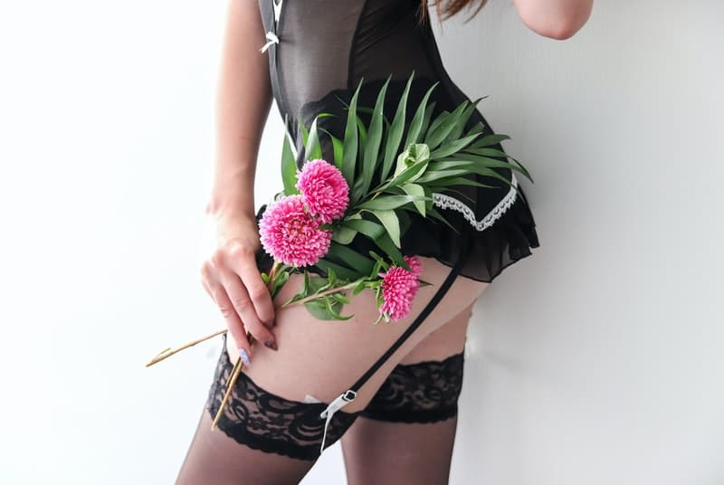 Woman holding flowers about to experience rimming