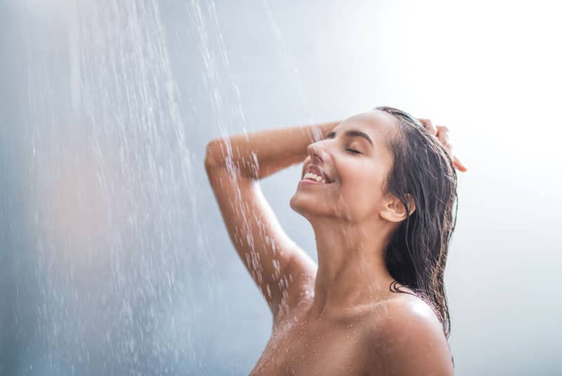 Woman showering prior to a yoni massage