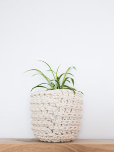 Back view of small eco plant pot - natural - Knttd coloured handmade plant pot cover made from recycled cotton yarn with watertight inner pot made from recycled plastic