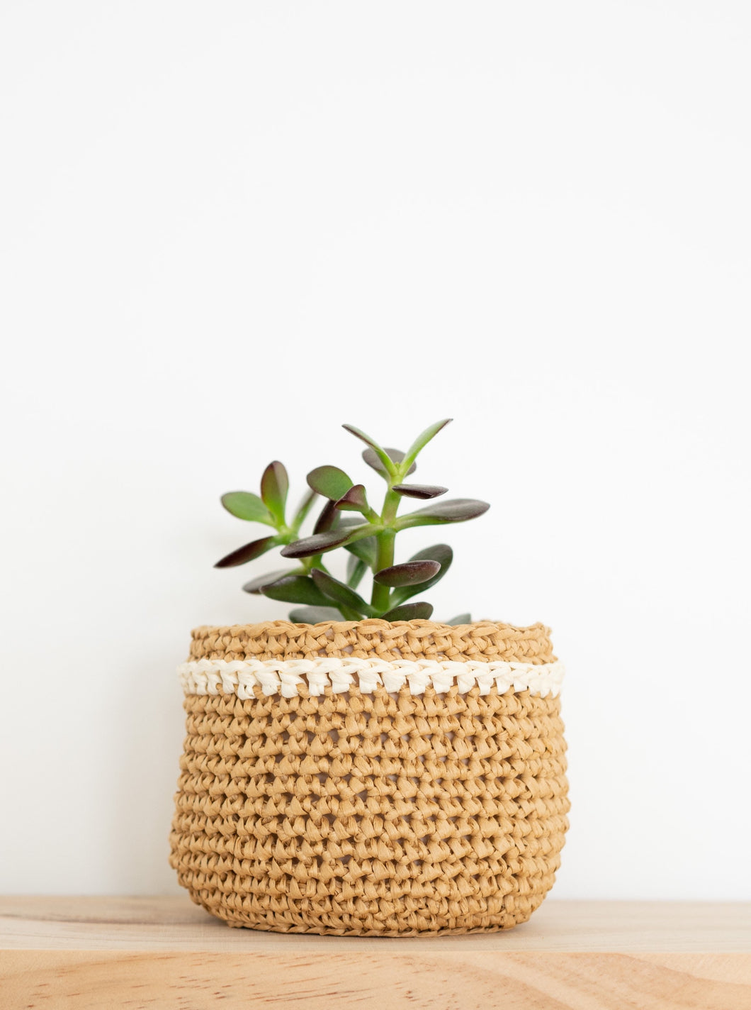 Mini raffia basket - natural - Knttd Made from raffia (wood fibre)It's really light weight, water repellant and biodegradable & vegan friendly!