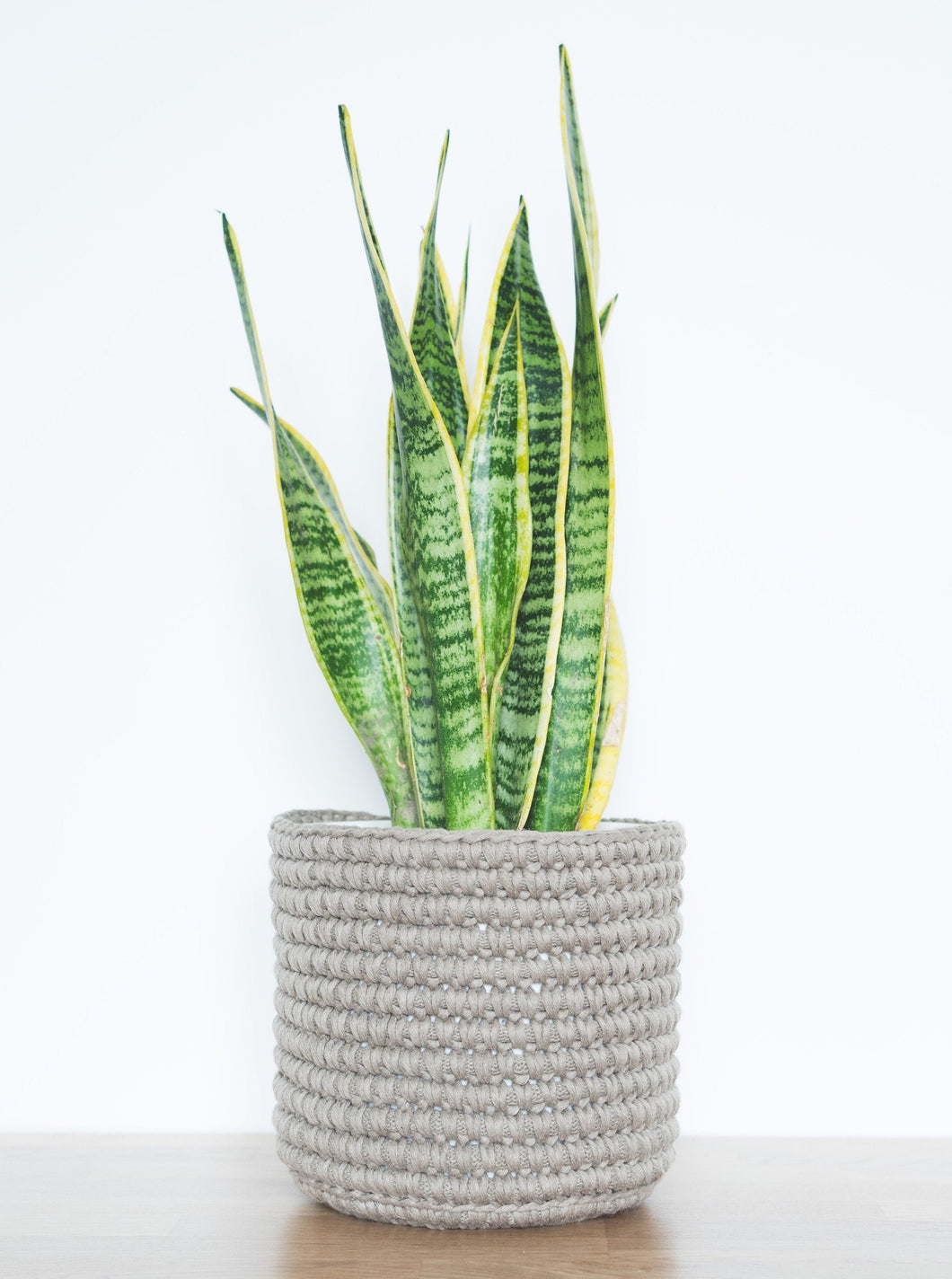 Medium eco plant pot - taupe - Knttd coloured handmade plant pot cover made from recycled cotton yarn with watertight inner pot made from recycled plastic