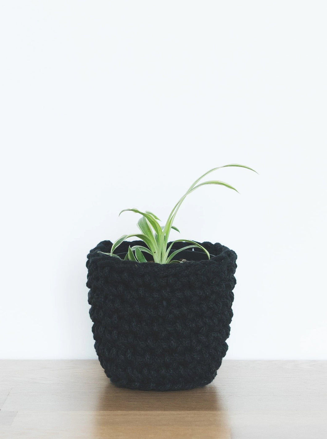 Mini eco plant pot - black - Knttd coloured handmade plant pot cover made from recycled cotton yarn with watertight inner pot made from recycled plastic