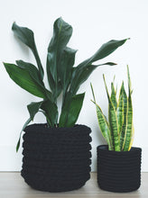Load image into Gallery viewer, Large eco plant pot - black - Knttd coloured handmade plant pot cover made from recycled cotton yarn with watertight inner pot made from recycled plastic