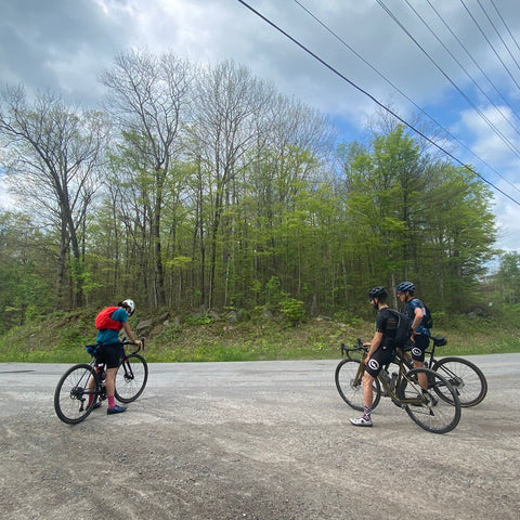 Cyclists stopped for a discussion on a backroad