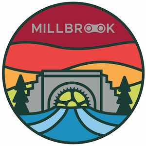 Millbrook MTB logo, a stained glass-style image of a bridge which is also a bike gear