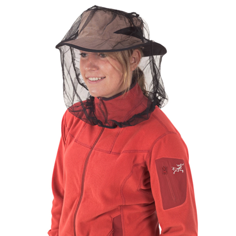 Person wearing a Sea to Summit mosquito net over their hat and face