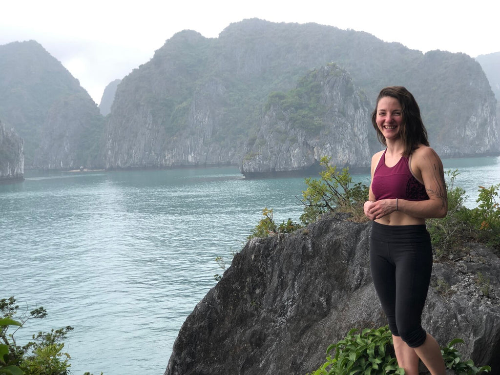 Wild Rock staffer Tori Silvera next to a lake in Southeast Asia
