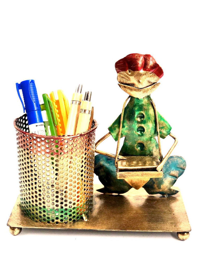 Creative Metal Pen Stand With Man Playing Musical Instrument Tamrapatra