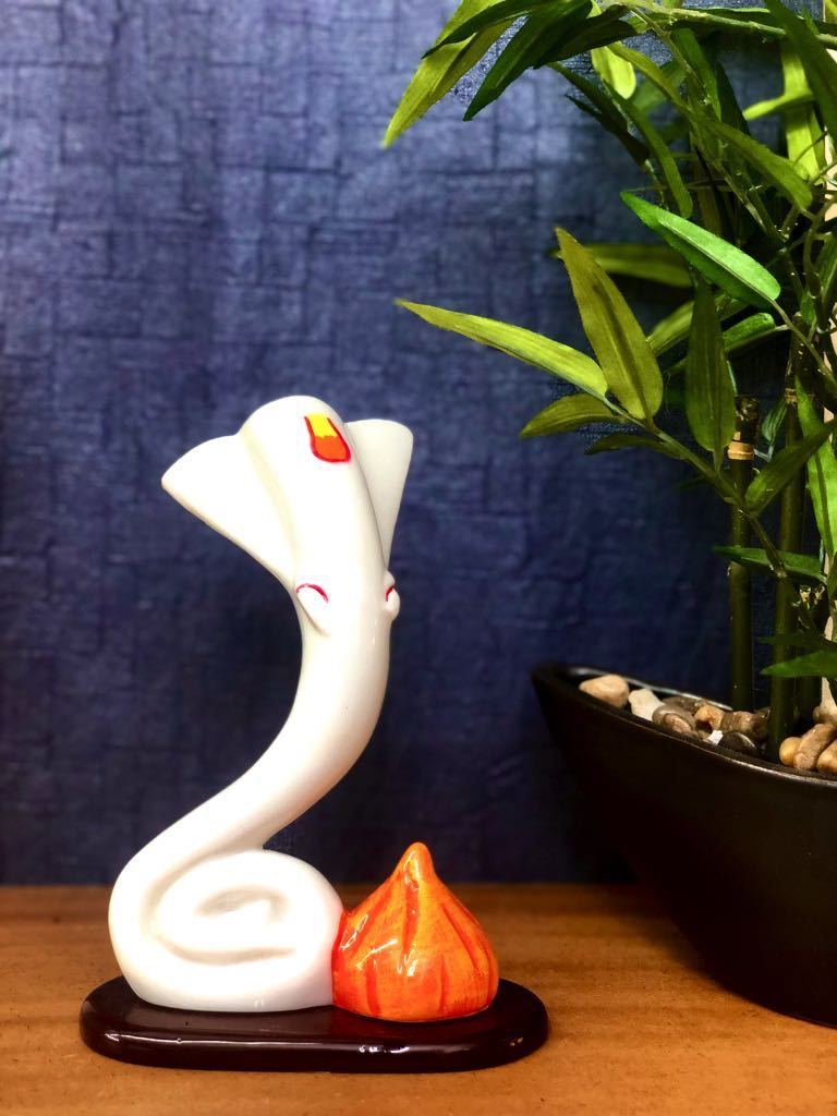 Ganesha With Modak In Sleek 3 Styles White Resin From Tamrapatra - Tamrapatra