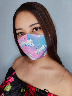 Pink blue unicorns face mask
