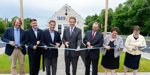 New York Governor Andrew M. Cuomo and others cut the ribbon to commemorate the opening of the first Taste NY location in June, 2014.  Taste NY at Todd Hill was the first market to open, as other cafes, stores, and Welcome Centers followed in the coming years.