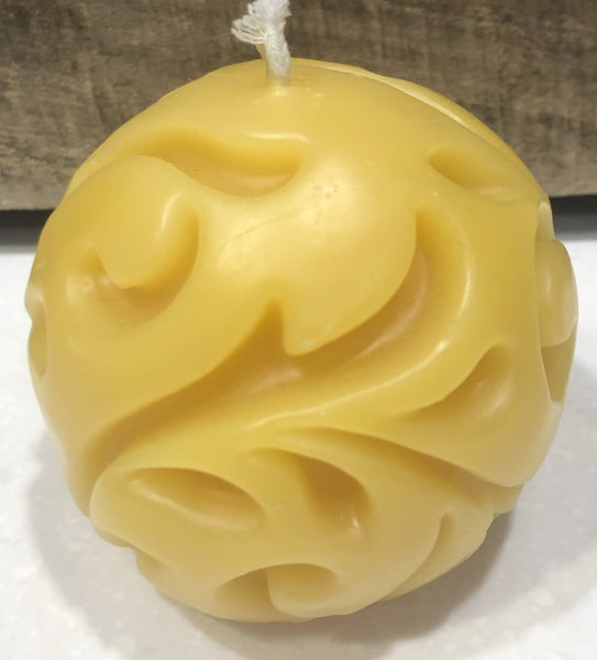 "Ornate spherical candle will burn for several hours.  Handmade 100 % Pure Beeswax. They are environmentally friendly, burn cleaner and longer than any other candles. No fragrance added just the naturally pleasant scent of pure beeswax.    Approximately 4"" wide, round."