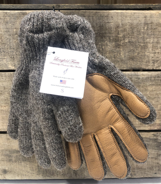 Knitted in a local mill, Longfield Farm wool gloves have super-soft acrylic liners and hand sewn bison palms to ensure warmth and durability.  This item is size small ; fits small-medium women's hand, small men's hand, or large child's hand.  The wool color is muted brown heather, and the deer skin palm is a rich tan color.