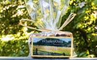Non-gmo whole grain oats, organic extra virgin coconut oil, pure honey, non-gmo brown sugar, almond meal, almonds, cranberries, blueberries, cherries and pure vanilla extract.   1 bar per package.  Made by Wholey Oats in the Hudson Valley.