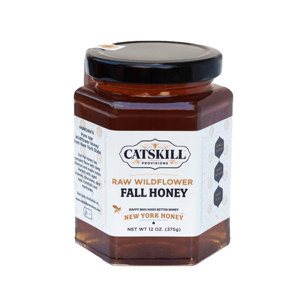Catskill Provisions Fall Honey is dark, rich honey harvested in mid-autumn when bees feed on chestnut, maple, goldenrod, sunflowers, cornflowers, asters, and daises. This honey is perfect with tea, cocktails, hard cheeses, and buttered toast.  This kosher honey is raw and never heated, which maintains all of the antioxidants and amino acids that are lost in large-scale produced honey. Once you try raw, pure honey, you won't have it any other way.  12 oz. hexagonal glass jar