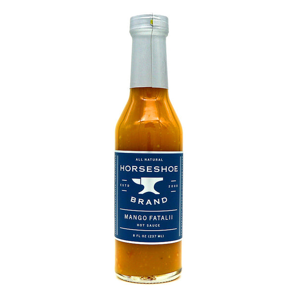 Plump mangoes and exotic fataliI peppers give this hot sauce the perfect blend of sweet and scorching. This well balanced sauce will crown any dish you pair it with. Excellent on chicken, pork and seafood.  8 oz. glass bottle with tamper resistant wrapping.