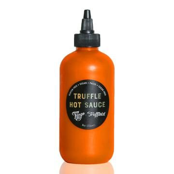 The Truffleist partnered with  Tango Chile Sauce so you can bring the heat with your truffle game with this limited edition hot sauce. Use it as a dipping sauce for fries and chicken wings, or top your favorite food like avocado toast and nachos.  This is a mild hot sauce.    Ingredients:  Carrots, apple cider vinegar, garlic, limes, chile peppers, sawtooth cilantro, truffles, sea salt, truffle flavoring.  8 oz. plastic bottle with screw top dispenser. Bottle has a tamperproof seal.