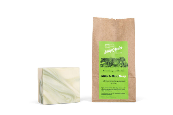 Soothe and revive extra-dry or sensitive skin with Sallye Ander's Milk & Mint Soap, which contains spearmint and barley grass to ease inflammation and repair damaged skin. Ingredients: olive oil blend, milk, barley grass and spearmint essential oil net weight 5 oz paper bag