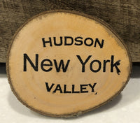 "Take a piece of the Hudson Valley home with you or give as a gift.  Made of fruitwood from a local orchard and ink stamped.  Magnetic strip on back.    Sizes vary, approximately 3"" x 4"" x 1/4"" thick"
