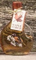 Beautiful basquaised printed glass bottle of maple syrup.  Designs include bluebird, cardinal and oriole.  250mL glass bottle