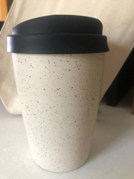 "This keep cup is made with a slightly tapered shape to fit comfortably in most car cup holders. keep in mind, this cup will get warm with the heat of your beverage.  This item is hand made so no two pieces are exactly alike. please expect slight variations in size, shape and finish. it is made using food safe clay and glazes.  approximately 4.5"" tall + the height of the lid, holds approximately 10 oz"