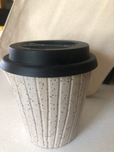 "This keep cup is made with a slightly tapered shape to fit comfortably in most car cup holders. keep in mind, this cup will get warm with the heat of your beverage.  This item is hand made and hand carved so no two pieces are exactly alike. please expect slight variations in size, shape and finish. it is made using food safe clay and glazes.  approximately 3.5"" tall + the height of the lid, holds approximately 8 oz"