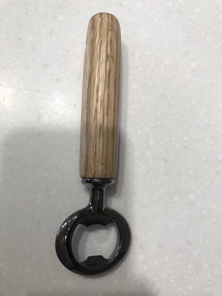 "Quick and easy to pop the top off of your favorite bottled beverage.  Wooden handles are expertly turned on a lathe.  Local hardwoods are selected to bring you an enduring and sturdy utility item that will last for decades.  Sanded, shellac finish and metal work.  Approximately 6"" long."