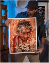 Painter Sean Diediker holding a fine art reproduction print of The Flower Woman based on an encounter with a local Balinese woman in Ubud Bali Indonesia.