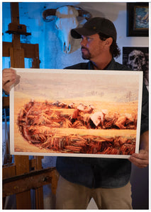 Artist Sean Diediker holding a fine art reproduction of his painting Rice Field Workers inspired by his travel to Bali Indonesia.