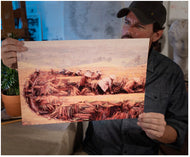 Painter Sean Diediker holding a print of his artwork Rice Field Workers he created after rising Bali Indonesia as shown on Canvasing The World with Sean Diediker.