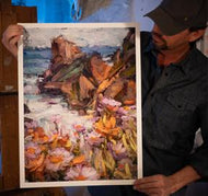Painter Sean Diediker holding a fine art reproduction of his artwork from Canvasing The World Big Sur California.