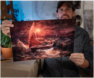 Artist Sean Diediker holds a fine art reproduction of his work Sherlock.