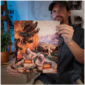 Painter Sean Diediker holding a fine art reproduction of The Keepers, inspired by beekeepers in Santa Barbara California USA