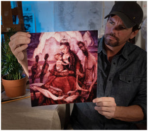 "Artist Sean Diediker holding a print reproduction of ""The Stolen Generation"" as shown on Canvasing The World Aboriginal culture of Blue Mountains Australia."