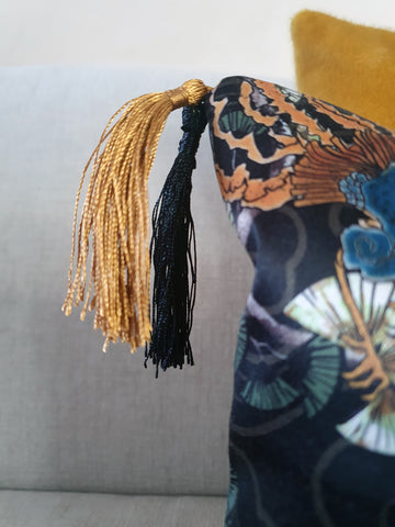 silky double tassels in gold ochre yellow and black hang delicately from the corner of the oriental double tassel cushion from Hazeldee Home