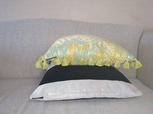 Yellow Palm Jacquard Fringe Cushion stack of cushions