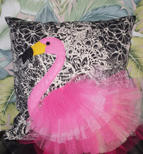 "Load image into Gallery viewer, Handmade flamingo bird illustration character cushion with 3D feather effect trim.     A great conversational flamingo cushion for kids and grown ups alike!  Bring some fun and colour into your space with this handmade cushion with a pink flamingo cushion with plume of pink feather-like trim with a twill fabric floral monochrome base!  A one-of-a-kind Hazeldee Home design.  Approximately 16"" x 16"" (40cm x 40cm) with a centre back zip. Comes with a polycotton cushion inner."