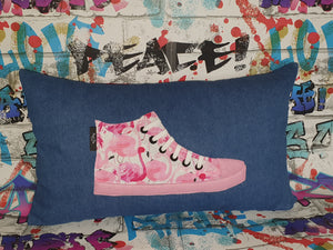 "Hazeldee Home Handmade hi-top trainer cushion, rectangular bolster shape with real laces trim on a blue denim base.  A great conversational trainer cushion for kids and grown ups alike!  Bring some fun and colour into your space with this handmade cushion with a hi-top trainer with laces detail!  Bold flamingo print hi-top sneaker trainer cushion with contrast pink detail.  Approximately 12"" x 20"" (30cm x 50cm) with a zip opening.   Comes with a polycotton cushion inner."