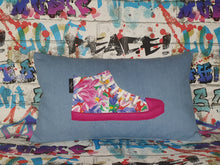 "Load image into Gallery viewer, Hazeldee Home Handmade hi-top trainer cushion, rectangular bolster shape with real laces trim on a blue denim base.  A great conversational trainer cushion for kids and grown ups alike!  Bring some fun and colour into your space with this handmade cushion with a hi-top trainer with laces detail!  Bold floral print hi-top sneaker trainer cushion with contrast fuchsia pink detail.  Approximately 12"" x 20"" (30cm x 50cm) with a zip opening.   Comes with a polycotton cushion inner."