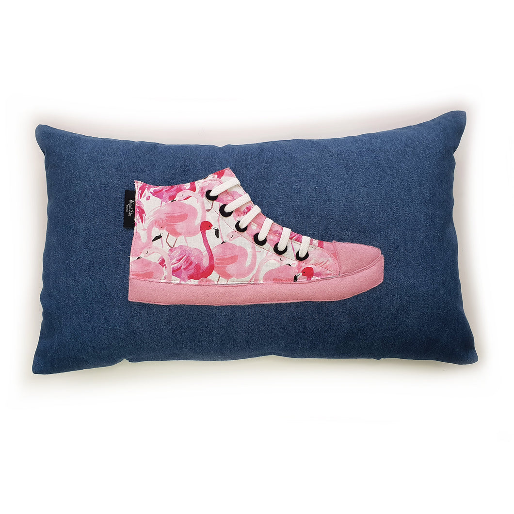 Hazeldee Home Handmade hi-top trainer cushion, rectangular bolster shape with real laces trim on a blue denim base.  A great conversational trainer cushion for kids and grown ups alike!  Bring some fun and colour into your space with this handmade cushion with a hi-top trainer with laces detail!  Bold flamingo print hi-top sneaker trainer cushion with contrast pink detail.  Approximately 12