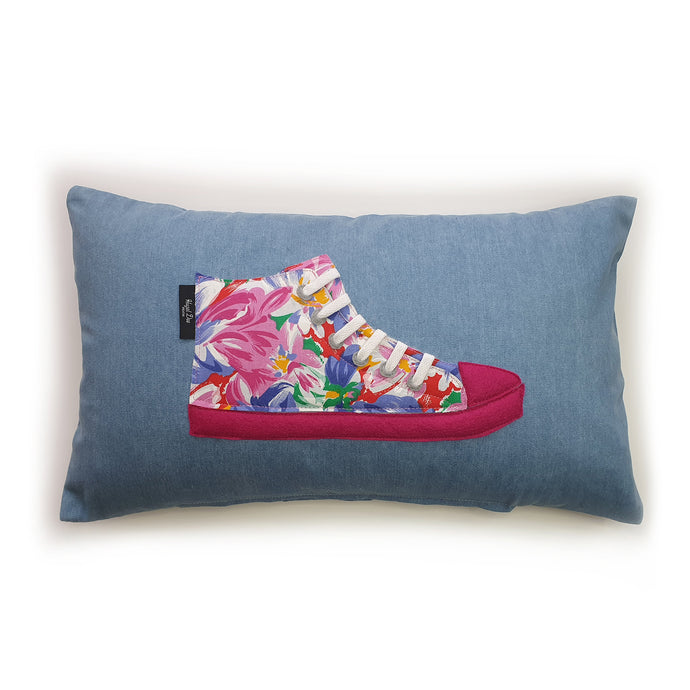 Hazeldee Home Handmade hi-top trainer cushion, rectangular bolster shape with real laces trim on a blue denim base.  A great conversational trainer cushion for kids and grown ups alike!  Bring some fun and colour into your space with this handmade cushion with a hi-top trainer with laces detail!  Bold floral print hi-top sneaker trainer cushion with contrast fuchsia pink detail.  Approximately 12