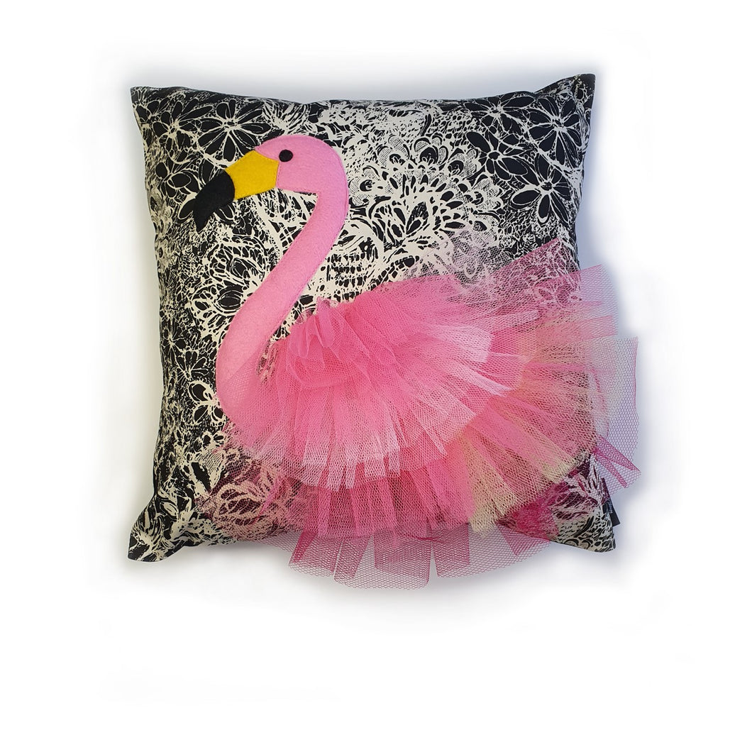 Handmade flamingo bird illustration character cushion with 3D feather effect trim.     A great conversational flamingo cushion for kids and grown ups alike!  Bring some fun and colour into your space with this handmade cushion with a pink flamingo cushion with plume of pink feather-like trim with a twill fabric floral monochrome base!  A one-of-a-kind Hazeldee Home design.  Approximately 16