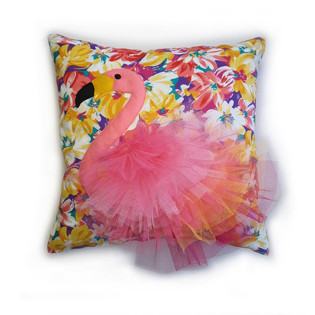 Handmade flamingo bird illustration character cushion with 3D feather effect trim.       A great conversational flamingo cushion for kids and grown ups alike!  Bring some fun and colour into your space with this handmade cushion with a pink flamingo cushion with plume of pink feather-like trim with a bright floral fabric base!  A one-of-a-kind Hazeldee Home design.   Approximately 16