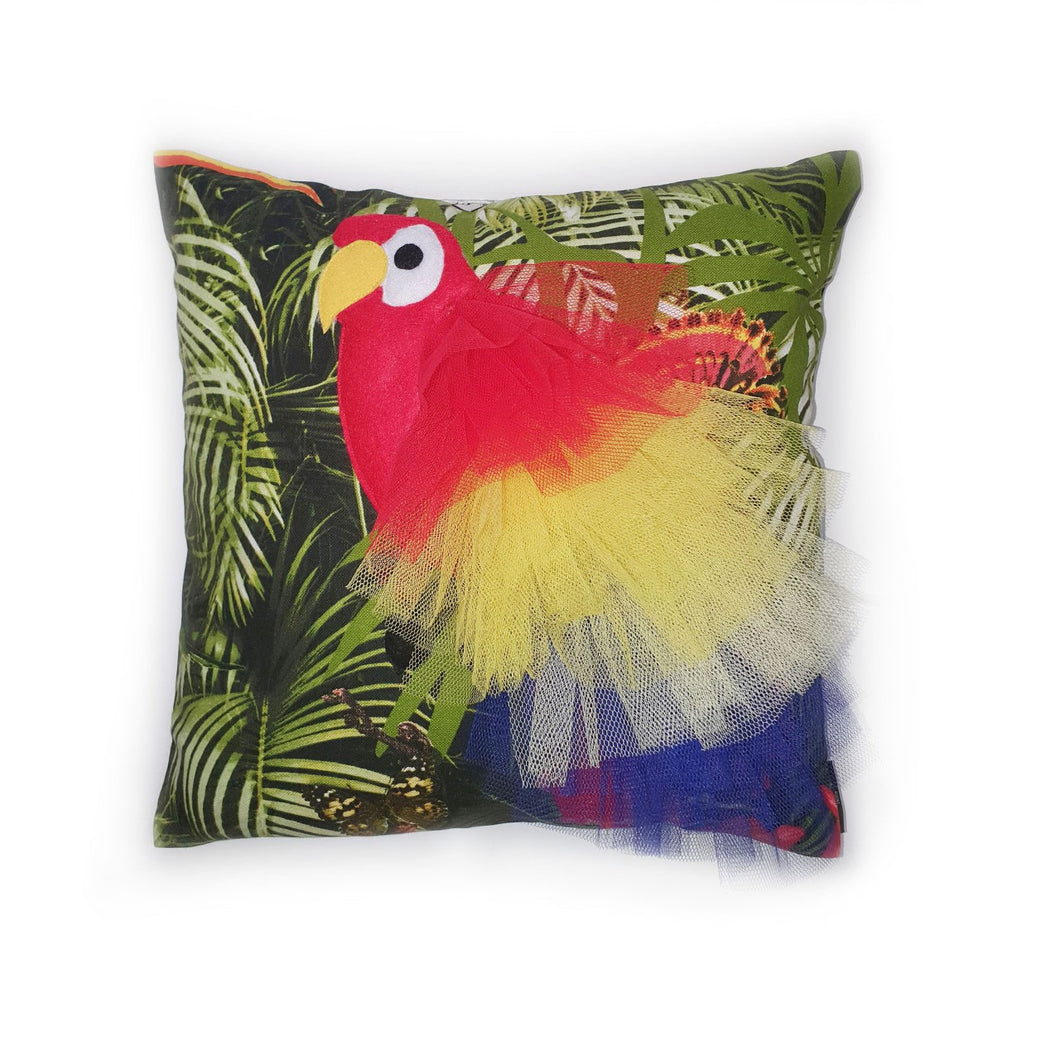 Handmade Parrot bird illustration character cushion with 3D feather effect trim.      A great conversational parrot cushion for kids and grown ups alike!  Bring some fun and colour into your space with this handmade cushion with a bold red parrot cushion with plume of red, yellow and blue feather-like trim with a tropical leaf fabric base!  A one-of-a-kind Hazeldee Home design.  Approximately 16
