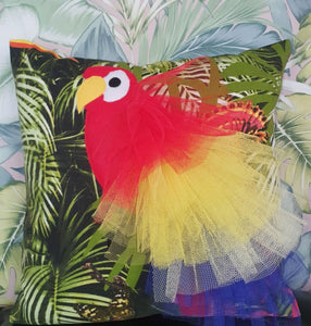 "Handmade Parrot bird illustration character cushion with 3D feather effect trim.      A great conversational parrot cushion for kids and grown ups alike!  Bring some fun and colour into your space with this handmade cushion with a bold red parrot cushion with plume of red, yellow and blue feather-like trim with a tropical leaf fabric base!  A one-of-a-kind Hazeldee Home design.  Approximately 16"" x 16"" (40cm x 40cm) with a centre back zip. Comes with a polycotton cushion inner."