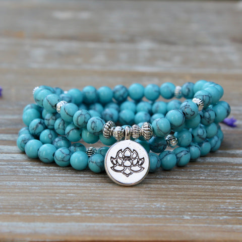 Turquoise Howlite Wrap Bracelet With Silver Coloured Lotus Charm.