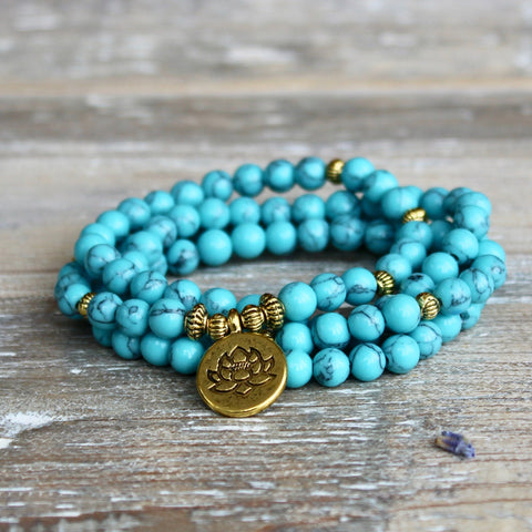 Turquoise Howlite Wrap Bracelet With Gold Lotus Charm and Gift Bag.