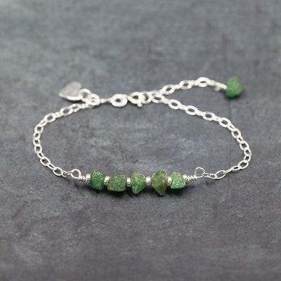 Sterling silver bracelet with raw emerald and sterling silver beads.